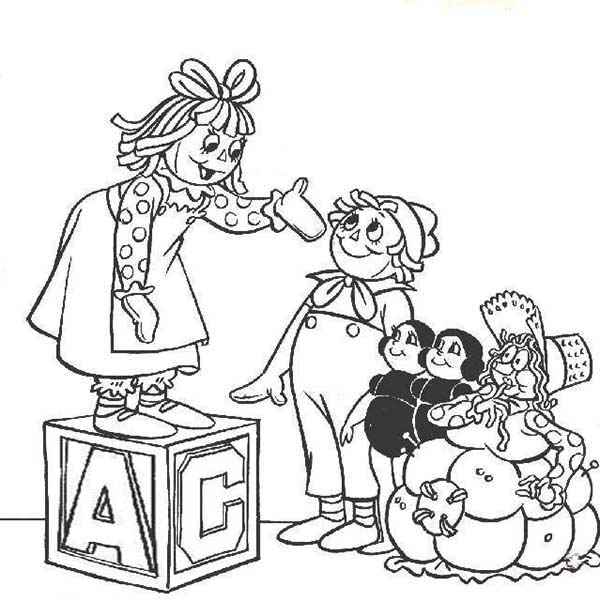 raggedy ann stand on a box and andy with their friends in raggedy ann and andy